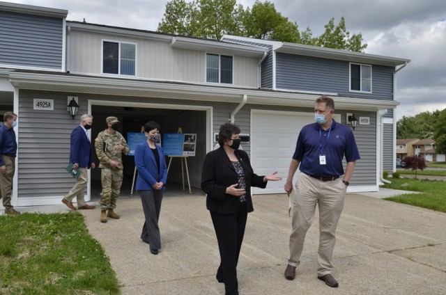 Karsten Haake, Lendlease project director for the Campbell Crossing community, gives Brenda Lee McCullough, director, U.S. Army Installation Management Command Directorate-Readiness, a tour of the New Hammond Heights community May 5.