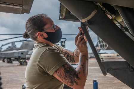Soldiers of the 25th Combat Aviation Brigade perform routine maintenance on AH-64 Apache Helicopters at Wheeler Army Airfield, Hawaii. Maintainers identify, troubleshoot, and repair any issues the aircraft may be experiencing.