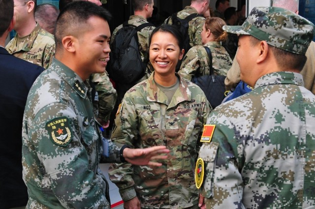U.S. Army Col. Danielle Ngo, then the commander of the 130th Engineer Brigade at Schofield Barracks, Hawaii, shares a laugh with members of the Chinese army while on break during the U.S.-China Disaster Management Exchange's Expert Academic Dialogue in Kunming, China, Nov. 9, 2016.