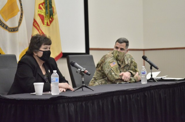 Brenda Lee McCullough, director, U.S. Army Installation Management Command Directorate-Readiness, addresses Fort Campbell's civilian workforce alongside Col. Jeremy D. Bell, Fort Campbell garrison commander, May 5 during a garrison workforce town hall hosted in the Eagle Conference Room.