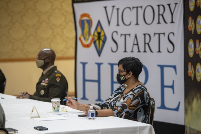 Pam Beagle, wife of Fort Jackson Commander Brig. Gen. Milford H. 'Beags' Beagle Jr., asks a question during the Military Spouse Appreciation Day event at the NCO Club May 7. The event highlighted, honored spouses' contributions to Fort Jackson.