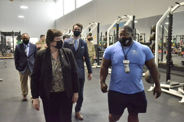 Brenda Lee McCullough, director, U.S. Army Installation Management Command Directorate-eadiness, tours the recently renovated Olive Physical Fitness Center May 4 during a visit to Fort Campbell.
