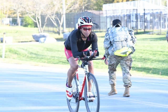 More than a dozen community members gathered at Magrath Sports Complex for a sprint triathlon, hosted by Fort Drum Family and Morale, Welfare and Recreation (FMWR). The staff designed the event to allow participants the option to either use a spin bike or ride their own road bike on a 12-mile course outside. This was one of many activities planned this month at Fort Drum in support of the Army Strong B.A.N.D.S. (Strong Balance, Activity, Nutrition, Determination and Strength) campaign. (Photo by Mike Strasser, Fort Drum Garrison Public Affairs)