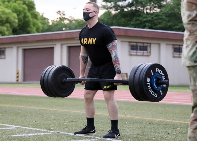 Spc. Brendan Parmenter, assigned to 311th Military Intelligence Battalion, competes in the deadlift portion of the Army Combat Fitness Test during the 2021 U.S. Army Japan Best Warrior Competition at Camp Zama, Japan, May 12.