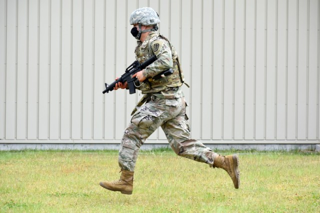 Spc. Jorden Moore, assigned to the 311th Military Intelligence Battalion, competes in the react-to-contact lane during the 2021 U.S. Army Japan Best Warrior Competition at Sagami General Depot, Japan, May 12.