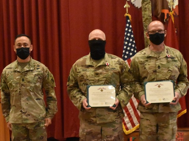 Colonel John Haas Jr., Task Force Essayons Commander, and Sergeant Major William Klaers, Senior Enlisted Advisor, Task Force Essayons, display their Meritorious Service Medals presented to them by Command Sergeant Major Delfin Romani, Transatlantic Division CSM on May 15, 2021.