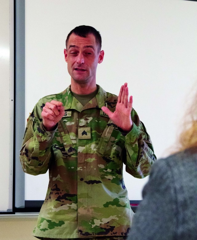 Michigan Guard Soldier helps at vaccination events with sign language