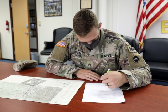 Sgt. Nicholas Scelsi, assigned to the 247th Military Police Detachment, takes a land navigation exam during the 2021 U.S. Army Japan Best Warrior Competition at Camp Zama, Japan, May 11.