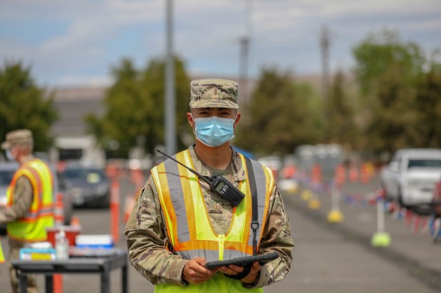 U.S. Army 2nd Lt. Justin Sinlao, a medical surgical nurse from Brooke Army Medical Center in San Antonio, scans his car lane during vaccination operations at the Community Vaccination Center (CVC) at State Fair Park in Yakima, Washington, May 12, 2021. Sinlao is part of a group of Soldiers from 62nd MED BDE are deployed to the Yakima CVC in support of the Department of Defense COVID response operations to help communities in need. U.S. Northern Command, through U.S. Army North, remains committed to providing continued, flexible Department of Defense support to the Federal Emergency Management Agency as part of the whole-of-government response to COVID-19. (U.S. Army Photo by Spc. Preston Robinson)