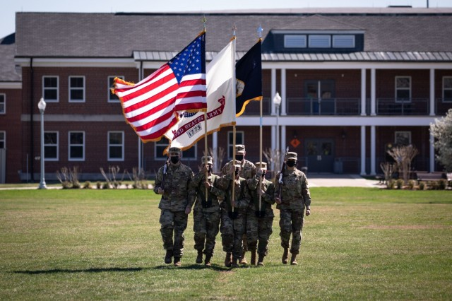 The colorguard of the United States Army Reserve Legal Command retires the colors during a change of command ceremony held Friday, March 26 on Joint Base Myer-Henderson Hall, Virginia.