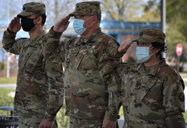 Capt. Alex Singh, outgoing commander (left), Col. Cliffton Cornell, 94th Training Division-Force Sustainment Chief of Staff (center), and Capt. Theang Sterns, incoming commander (right), render a salute during the playing of the National Anthem at the 94th TD-FS Headquarters and Headquarters Company change of command ceremony. The ceremony was held at Fort Lee's Combined Arms Support Command Headquarters to bid farewell to Singh and welcomed Sterns as the 94th TD-FS HHC commander on April 9, 2021. (Photo by Maj. Ebony Gay, 94th TD-FS Public Affairs Office)