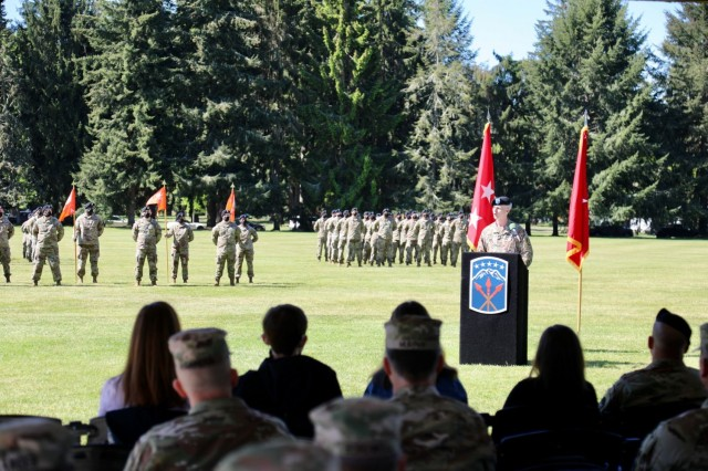 """Brig. Gen. Timothy P. White relinquished his duties as the 593rd Expeditionary Sustainment Command commanding general during the ESC change of command ceremony at Watkins Field here at Joint Base Lewis-McChord, May 14, 2021.    """"To the Soldiers, NCOs, Officers, and families of the 593rd Expeditionary Sustainment Command, I am so proud of all you,"""" White said.  """"Your contributions to our nation are often understated, but never, ever unappreciated.""""  """"From the 112th Military Mail Terminal mail clerks that work in our post office to the (assigned) doctors and nurses that work at Madigan Army Medical Center, you professionally and humbly serve our community every day,"""" continued the native of Spencer, Massachusetts.  """"I appreciate all that you do to make our unit, our Corps, our Army, our Nation, and our world a better place.  I was proud to serve you, and I wish you all continued success regardless of where your journeys take you.""""  White relinquished his position as the organization welcomed Col. Martine S. Kidd and Command Sgt. Maj. Terrence T. Scarborough as the organization's new command team. (U.S. Army photo by Sgt. 1st Class Tony White, 593rd ESC)"""