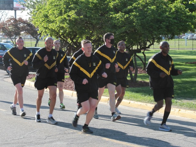 Maj. Gen. Darren Werner (front left), Commanding General U.S. Army Tank-automotive and Armaments Command, and Command Sgt. Maj. Jerry Charles, TACOM, led a running formation of Soldiers during the run/walk event for AER at the Detroit Arsenal, Michigan May 14.