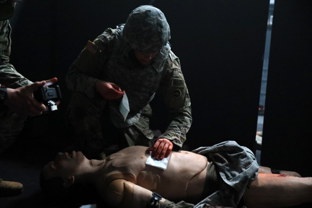 Spc. Kyle Hunsaker, assigned to the 247th Military Police Detachment, competes in the medical lane during the 2021 U.S. Army Japan Best Warrior Competition at Sagami General Depot, Japan, May 12. Hunsaker came in second in the competition's Soldier category.