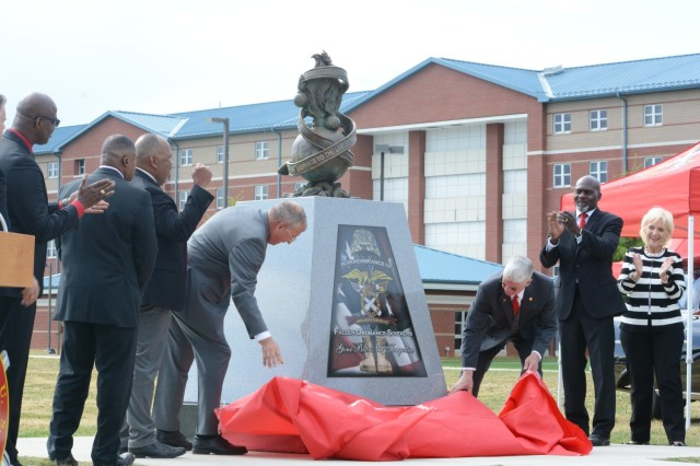 Members of the Ordnance Corps Association unveil a memorial dedicated to fallen Soldiers May 14, 2021, at Whittington Field on Fort Lee. The statue was also created to honor the centennial of the Army Ordnance Corps, which occurred May 14, 2012.