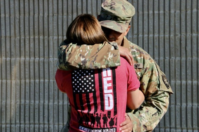 Staff Sgt. Luis Gonzalez, military police with the 50th Regional Support Group, says goodbye to his girlfriend prior to his deployment at the Homestead armory in Homestead, Florida.