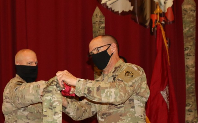 With Task Force Essayons consolidating within the Transatlantic Expeditionary District, the colors of the former command will remain cased, as Colonel John Haas, Jr. and SGM William Klaers complete this final act on May 15, 2021. (Photo by Rick Benoit)