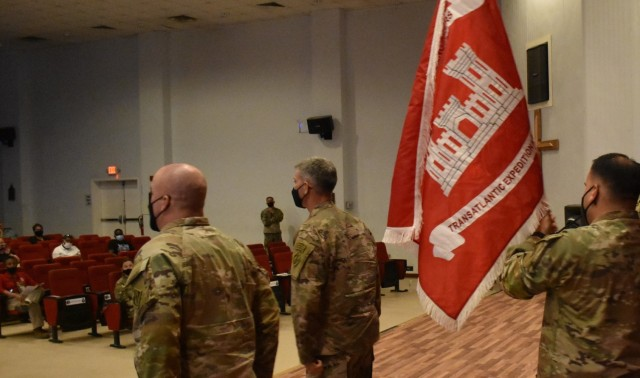 As Master Sergeant Ronald Brown, Senior Enlisted Advisor, and Colonel Mark Geraldi, Commander Pivot around to those attending the uncasing ceremony, they present the flag of the Transatlantic Expeditionary District on this date, May 15, 2021 from Camp Arifjan, Kuwait.  (Photo by Rick Benoit)
