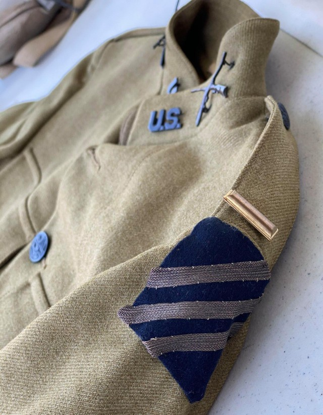 The WWI uniform of 2nd Lt. Delmore Adams is displayed during a terrain walk and battle analysis event that replaced the traditional staff ride held by the University of Maine Army ROTC program April 24, 2021. A veteran of 3rd Infantry Division and a resident of Maine, Adams was twice awarded the French Croix de Guerre as well as the Silver Star for his bravery as part of the 3rd ID in 1917-1918.  Artifacts like the uniform were used to teach cadets about what individuals like themselves did when put into harrowing situations in the crossroads of history. (Courtesy Photo, Capt. Jonathan Bratten)