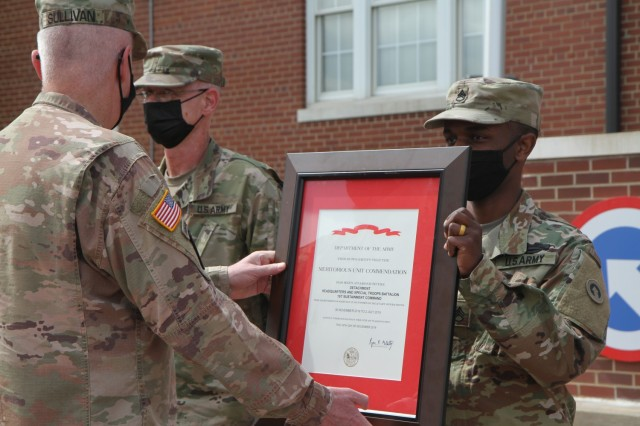 Staff Sgt. Nahjier Williams, public affairs noncommissioned officer, 1st Theater Sustainment Command,  represents the 1st TSC noncommissioned officers as the unit is awarded the Meritorious Unit Commendation by Maj. Gen. John Sullivan, commanding general, 1st TSC, at Fort Knox, Kentucky, May 14, 2021. (U.S. Army photo by Pfc. Kaylee Harris 1st TSC Public Affairs)