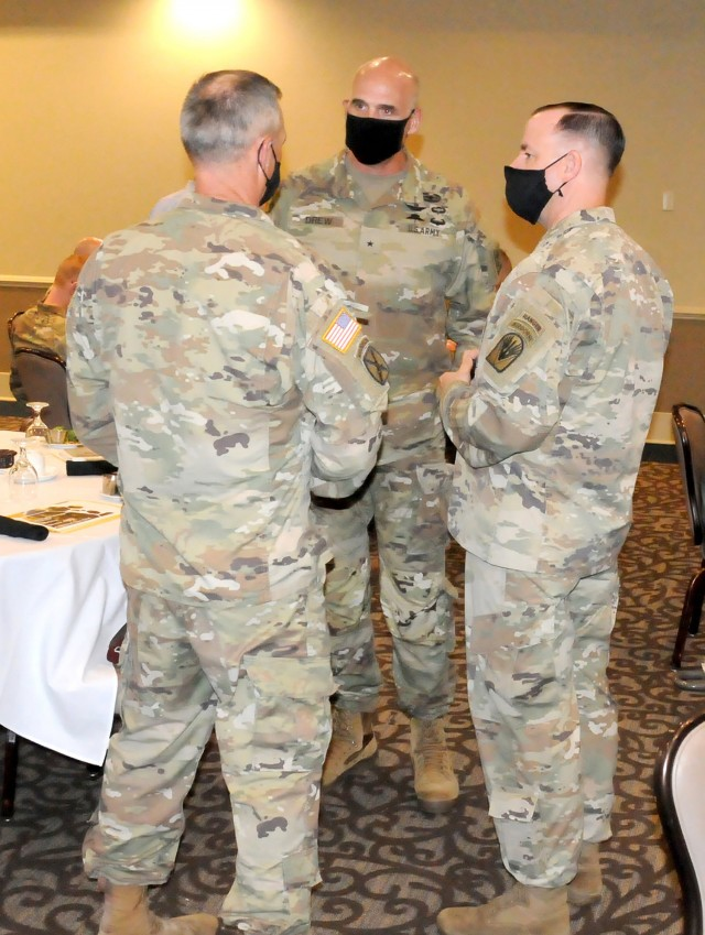 Brig. Gen. Thomas Drew, (center) director of the U.S. Army Talent Management Task Force, talks to Col. Duane Patin, (left) Joint Readiness Training Center and Fort Polk chief of staff, and Command Sgt. Maj. Michael C. Henry, (right) post command sergeant major, on a visit  to Fort Polk April 28 and 29 to present briefs on the Army Talent Management Program to the installation's senior leaders, senior NCOs and officers and warrant officers.