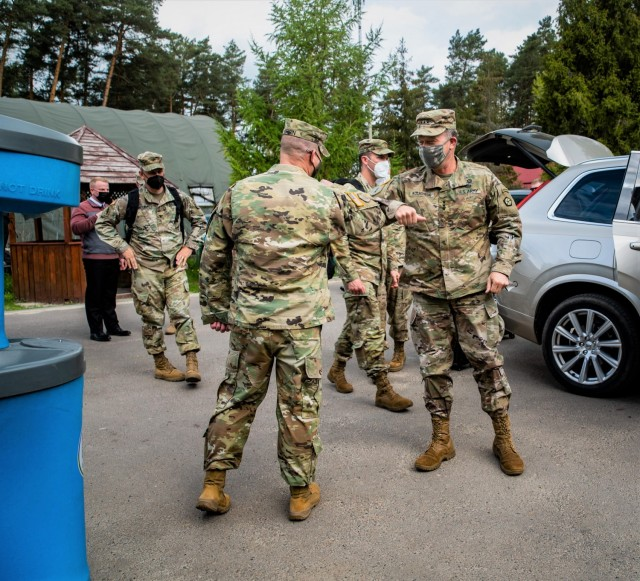 Lt. Gen. John S. Kolasheski, V Corps Commanding General, bumps elbows with Col James Perrin, Commander of Task Force Raven, 81st Stryker Brigade Combat Team, Washington Army National Guard, May 14, 2021, at the International Peacekeeping and Security Center near Yavoriv, Ukraine