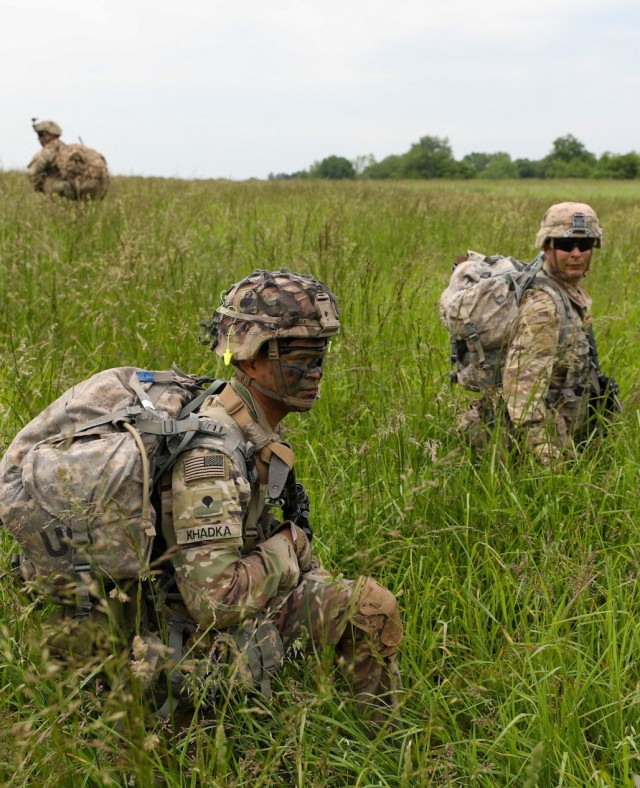 """Soldiers from 101 Airborne Division (Air Assault), 1st Brigade Combat Team, 2-327th """"No Slack"""", Charlie Company """"Cougars"""" pull security during a Deployment Readiness Exercise """"Operation Eagle Savage Strike"""" on May 17, 2021 at Fort Campbell, Ky.   The """"Cougars"""" executed different phases of the exercise to test their readiness in the event of a raid deployment order.   (U.S. Army photo by Spc. Kendall Lewis, 40th Public Affairs Detachment)"""