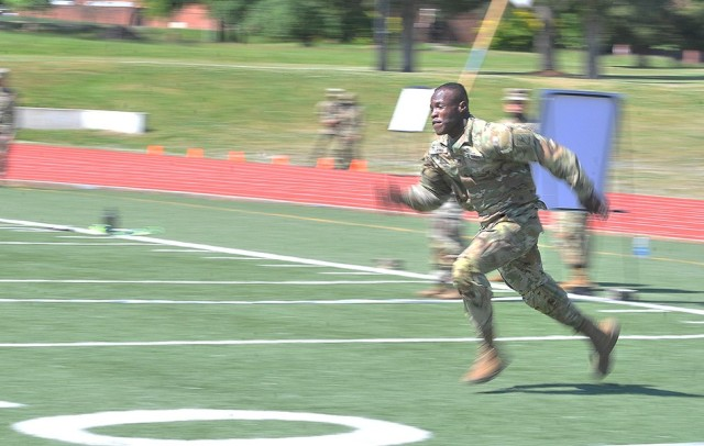 Spc. Kervins Accius, Bravo Company, 266th Quartermaster Battalion, dashes toward the halfway point of a sprint during the Dragon's Brigade's Soldier Stakes Competition May 14 at Williams Stadium.