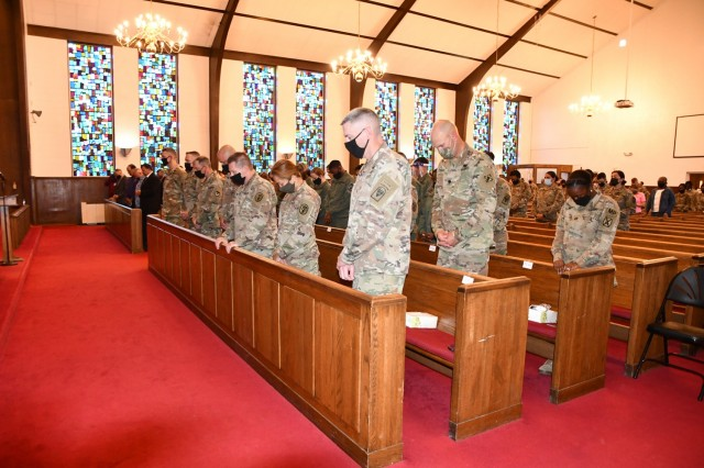 Those attending the Joint Readiness Training Center and Fort Polk National Day of Prayer breakfast, held at the Main Post Chapel May 6, bowed their heads to pray.