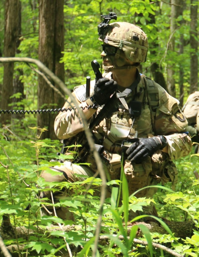 """A Soldier from the 101 Airborne Division (Air Assault), 1st Brigade Combat Team, 2-327th """"No Slack"""", Charlie Company """"Cougars"""" uses a radio to coordinate with their command team during """"Operation Eagle Savage Strike"""" on May 17, 2021 at Fort Campbell Kentucky.  The  intent of the exercise was to determine the readiness of the participating unit in the event of a rapid deployment order.  (U.S. Army photo by Spc. Jeremy Stillwagner, 40th Public Affairs Detachment)"""