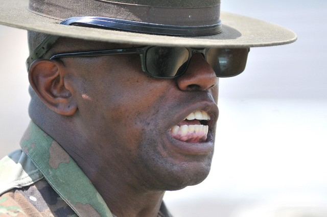 Staff Sgt. Robert Brown, a Papa Company, 244th Quartermaster Battalion drill sergeant, tries to motivate his charges during the Soldier Stakes Competition May 14 at Williams Stadium.
