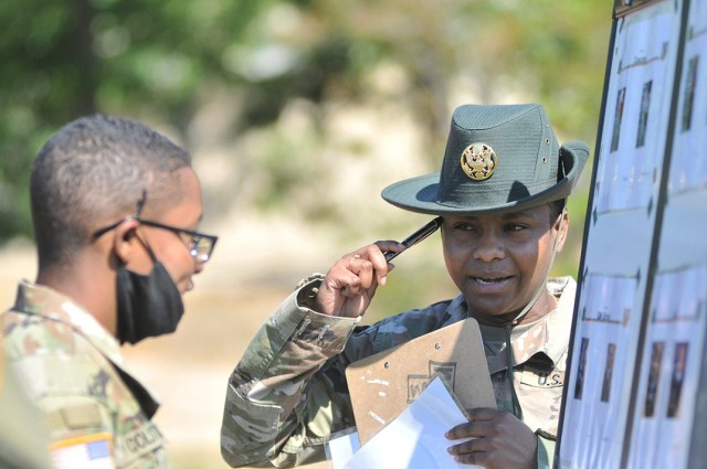 Staff Sgt. Jemima Thornton, a drill sergeant assigned to Mike Company, 266th Quartermaster Battalion, encourages a Soldier to give more effort during the change of command knowledge event of the Soldier Stakes Competition May 14 at Williams Stadium.
