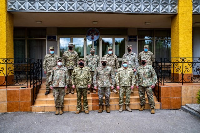 Lt. Gen. John S. Kolasheski, V Corps Commanding General, poses for a photo with U.S. and Ukrainian officers assigned to the Joint Multinational Training Group – Ukraine, during a visit to the Yavoriv Combat Training Center, May 14, 2021