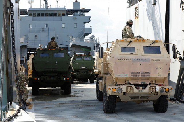 U.S. Army and U.S. Marine M142 High Mobility Artillery Rocket Systems are staged onto Logistics Support Vessel-4 LTG William B. Bunker, 8th Theater Sustainment Command, at Kin Red Beach Training Area Oct. 31. Orient Shield 21-1 is the largest U.S. Army field training exercise in Japan that tests and refines multi-domain operations.