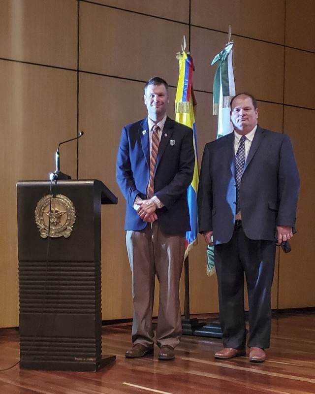Joseph Kidwell Jr., left, the Senior Central Case Manager, and Jason King, the Country Program Manager, both from U.S. Army Security Assistance Command, pose for a photo after a training class at the Colombian National Police headquarters, in Bogota, Colombia. Kidwell and King conducted various training classes on the Foreign Military Sales process to 140 members of the Colombian Military, to include Colombian Army, Army Aviation, Air Force, Navy, Marines  National Police, Narcotics, and Ministry of Defense. Also in attendance was the Colombian vice Minister of Defense, Mr. Jairo García. (Courtesy photo)