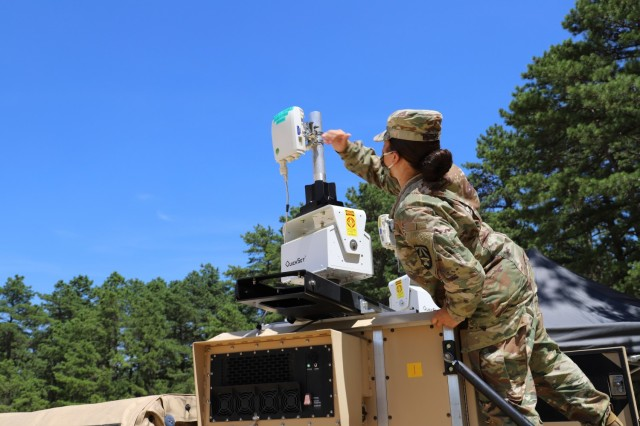 Staff Sgt. Keila Peters, an embedded noncommissioned officer within the C5ISR Center, conducts testing on equipment for the command post survivability effort during Network Modernization Experiment 20 at Joint Base McGuire-Dix-Lakehurst, N.J., July 27, 2020. The command post survivability effort focused on increasing the Army's command post survivability via technologies that enable command post dispersion and decrease command post signatures during combat operations.