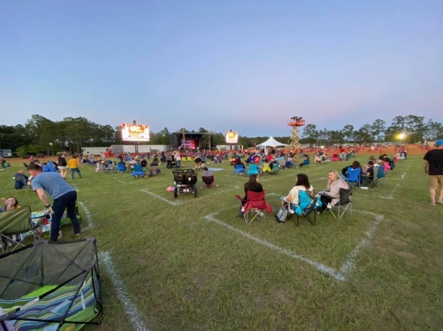 Families spread out on Donovan Field to maintain social distancing requirements during Big & Rich concert, May 15 on Fort Stewart.