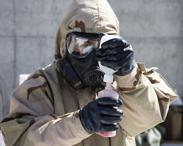 A Soldier from the 365th Chemical Company BIDS, 76th Operational Response Command, mixes the Agent Disclosure Spray, comprised of a proprietary powder and water. When sprayed on simulated or actual chemical agent, the spray changes color. Six U.S. Army Reservists and two Alabama National Guardsmen participated in the user demonstration April 20, 2021. Photos by Al Vogel, Dugway Public Affairs
