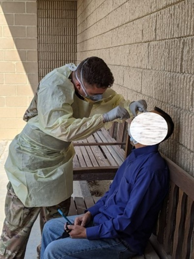 The 176th Optometry Detachment conducts COVID-19 swabs in support of COVID-19 Operations in Kuwait.