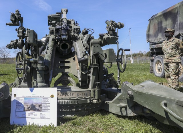 Command Sgt. Maj. Samuel Zoker, senior enlisted advisor, 41st Field Artillery Brigade, stands next to 2nd Cavalry Regiment's 155mm lightweight towed Howitzer on display as part of Dynamic Front 21 Academics Day, at Vilseck Army Air Field, Germany, May, 09, 2021. Dynamic Front 21 includes approximately 1,800 participants from 15 nations, May 3-21, 2021 at the U.S. Army's Grafenwoehr Training Area, Germany and Torun, Poland. DF21 is a 7th Army Training Command-led, U.S. Army Europe and Africa-directed exercise designed to increase readiness, lethality and interoperability by exercising allied and partner nations' ability to integrate joint fires in a multinational environment at both the operation and tactical levels.