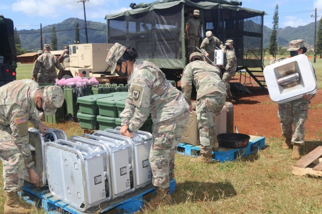 Culinary Specialists assigned to Headquarters and Headquarters Company, 311th Signal Command (Theater) set up a Mobile Kitchen Trailer and prepare to serve a meal to their fellow Army Reserve Soldiers in the field during range qualification operations at Schofield Barracks, Apr. 9, 2021.