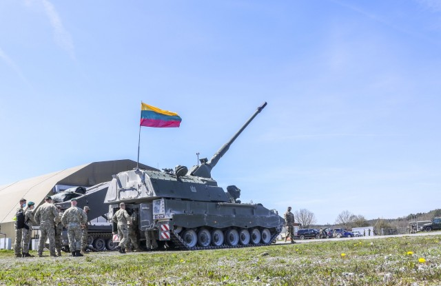 U.S. and Lithuanian Soldiers stand behind Lithuania's Panzerhaubitze 2000, on display as part of Dynamic Front 21 Academics Day, at Vilseck Army Air Field, Germany, May, 09, 2021. Dynamic Front 21 includes approximately 1,800 participants from 15 nations, May 3-21, 2021 at the U.S. Army's Grafenwoehr Training Area, Germany and Torun, Poland. DF21 is a 7th Army Training Command-led, U.S. Army Europe and Africa-directed exercise designed to increase readiness, lethality and interoperability by exercising allied and partner nations' ability to integrate joint fires in a multinational environment at both the operation and tactical levels.