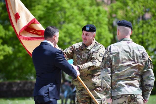 IMCOM-Europe Director Tommy R. Mize passes the U.S. Army Garrison Stuttgart colors to Col. Matt Ziglar, symbolizing the transfer of command. Photo by Jason Johnson