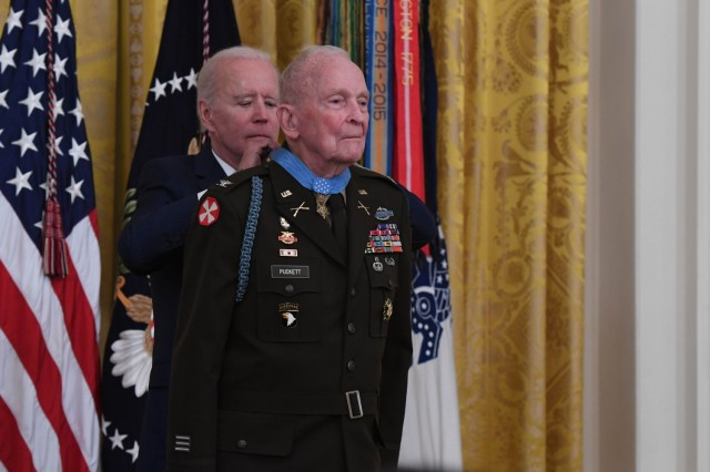 President Joseph Biden presents the Medal of Honor to retired Col. Ralph Puckett Jr. during a ceremony at the White House in Washington, D.C., May 21, 2021. Puckett was awarded the Medal of Honor for his heroic actions while serving then as commander of the Eighth Army Ranger Company when his company of 57 Rangers was attacked by Chinese forces at Hill 205 near the Chongchon River, during the Korean Conflict on November 25-26, 1950.