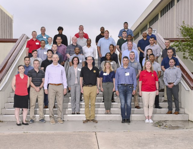 Pictured (front row from right to left): Sarah Bercaw, Cmd. Sgt. Major Daniel Hendrex, Lt. Gen. Theodore Martin, Maj. Gen. Dennis Lemaster, alongside hand-selected, junior to mid-grade Soldiers and Civilian participants of the U.S. Army Training and Doctrine Command, or TRADOC's, Leadership, Resiliency, and Mentorship event pose for a group photo on May 18 during the first half of the TRADOC People First Symposium hosted at Joint Base San Antonio- Fort Sam Houston, Texas from May 17-20, 2021.