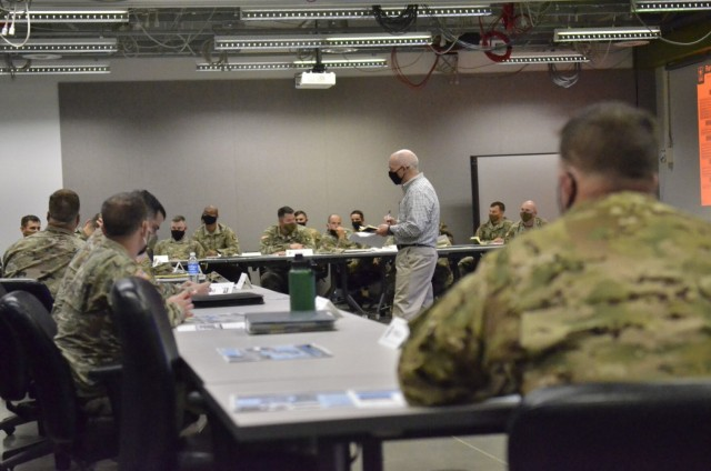 John Watson, chief, Training Division, Directorate of Plans, Training, Mobilization and Security, takes notes May 13 as Soldiers provide feedback during a Training Support Services Innovation Forum hosted at Kinnard Mission Training Complex.