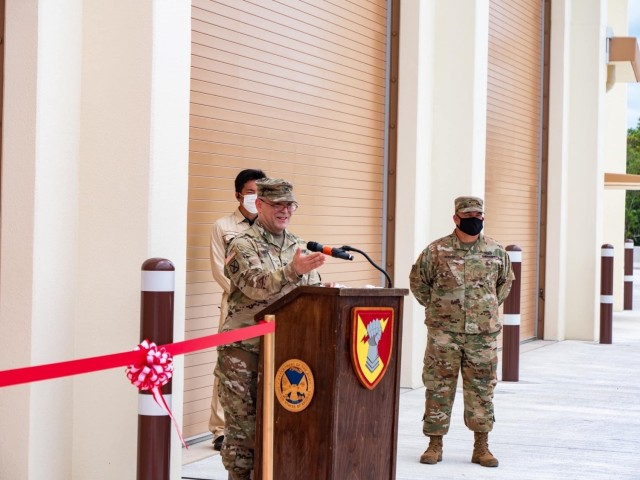 Col. Thomas J. Verell, Japan District, U.S. Army Corps of Engineers commander, and Lt. Col. Rosanna Clemente, 1st Battalion, 1st Air Defense Artillery Regiment commander, cut the ribbon during the Patriot Missile Storage Facility ribbon-cutting ceremony to celebrate the unveiling of the first MSF at Kadena Air Base, Japan May 19, 2021.