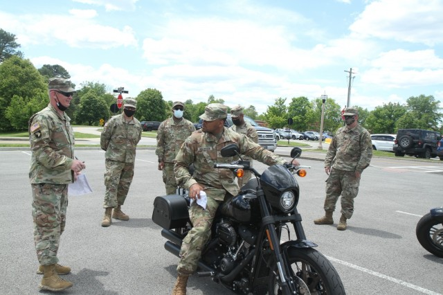 Soldiers of the 1st Theater Sustainment Command get their motorcycles inspected to ensure they meet all state and installation safety requirements for operation at Fort Knox, Kentucky, May 13, 2021. May is Motorcycle Safety Awareness Month and it is important for Soldiers to wear the prescribed personal protective equipment and practice safe riding habits to ensure individual and unit readiness. (U.S. Army photo by Staff Sgt. Nahjier Williams, 1st TSC public affairs.
