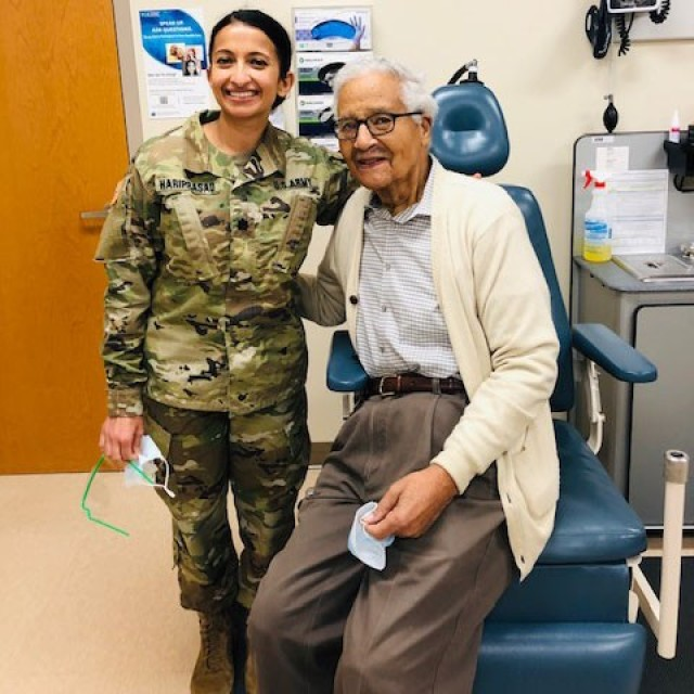 Army Lt. Col. Deepa Hariprasad poses for a photo with Charles McGee sometime in 2020 at Walter Reed National Military Medical Center, Md. McGee is one of the last living members of the Tuskegee Airmen.