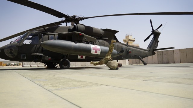 Staff Sgt. Brianna Pritchard, an Army National Guard UH-60 Black Hawk helicopter mechanic from Anchorage, Alaska, shows her Olympic breaking moves at Al Asad Air Base, Iraq.